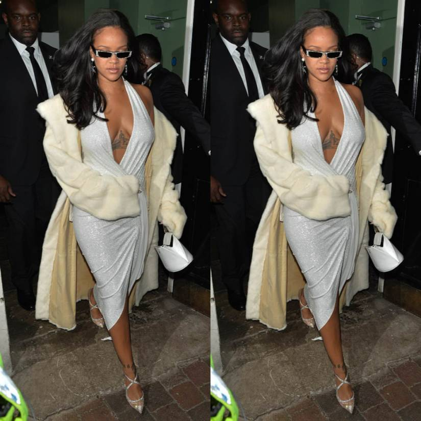 Rihanna Alexandre Vauthier glitter crystal halter gown New Year's Eve 2018 London, Christian Louboutin Twissima crystal pumps, Alain Mikli EdwidgeJeweled sunglasses, Calvin Klein white dome clutch, Sue Gragg earrings