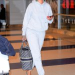 Rihanna Palace Skateboards sweatsuit Manolos Spuriasli slingback pumps, 47 New York Yankees Sure Shot hat, Balenciaga crystal flower drop earrings, Dior book tote