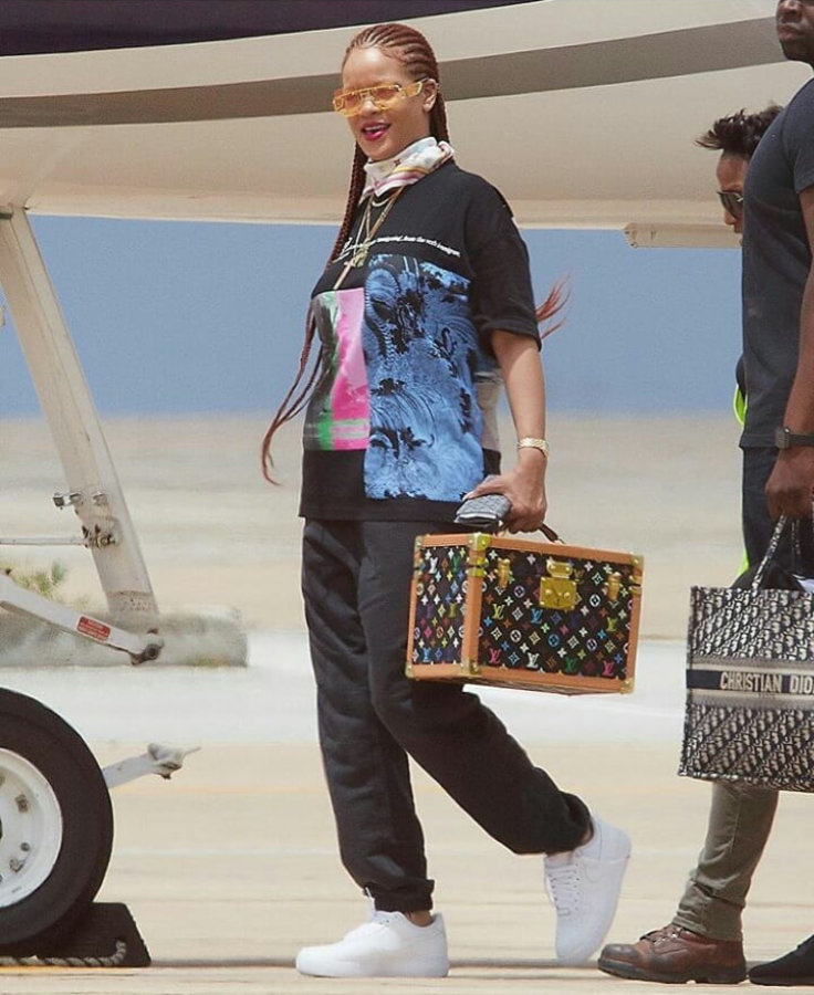 Rihanna Fenty Immigrant tee Barbados, Palace Skateboards black jogger, Nike Air Force 1 sneakers, Louis Vuitton scarf