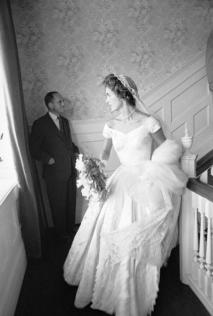 Socialite Jacqueline Bouvier in wedding dress on landing in home on day of her marriage to Sen. John Kennedy. (Photo by Lisa Larsen//Time Life Pictures/Getty Images)