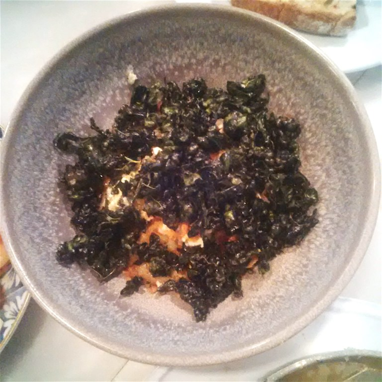 Ratte potato crispy kale, almonds, black olives, egg