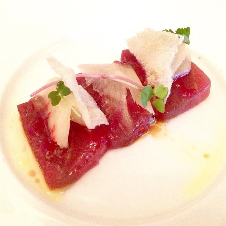 Tuna with dark tuna sauce, ginger marinated in vinegar and sugar, rice crisps with wasabi