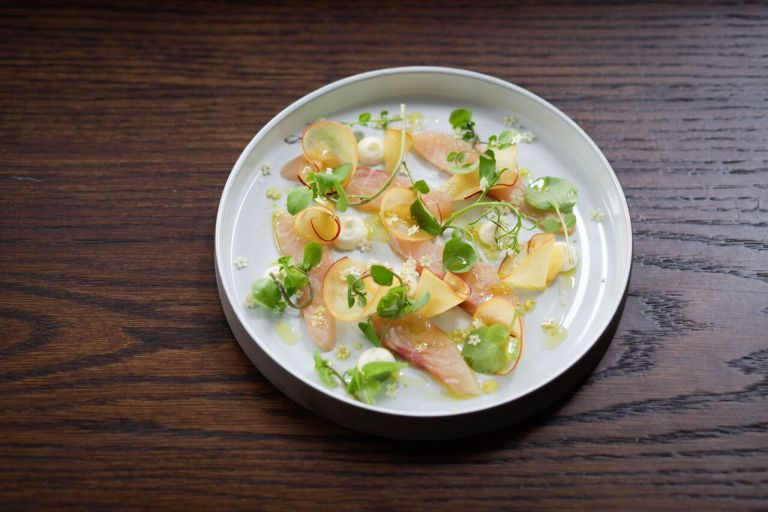 Char with peaches, water cress and lemon infused olive oil. Photo: Keiko Oikawa