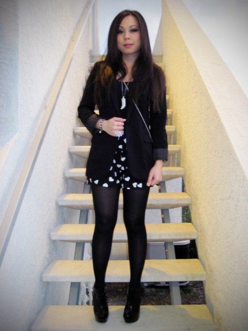 An Dyer in Express Boyfriend Blazer | Forever 21 Camisole, Necklace & Ring | Betsey Johnson Tights | H&M Rose Clutch | Steve Madden Raven Boots | Clear Watch from my Dad & Shorts from my Mom :)