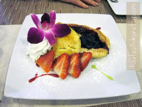 An Dyer in Neiman Marcus Zodiac Restaurant Raspberry Soufle topped with Creme Brulee and fresh berries