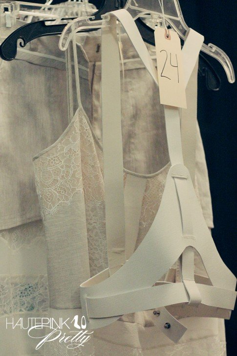BCBGMaxazria Runway SS13 Backstage Behind the Scenes - White Leather Harnesses next to lace harness