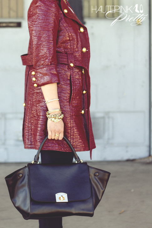 An Dyer wearing Juicy Couture Well Coiffed Belted Trench Coat, Cuore & Pelle Caterina Trapeze Bag