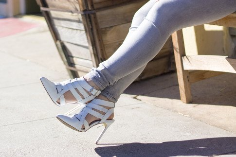 An Dyer wearing ShoeMint Garbo White Leather with Grey Jeggings