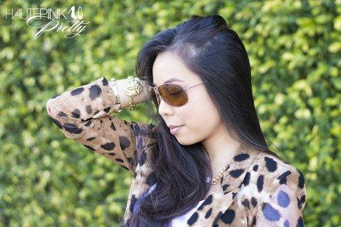 An Dyer wearing Vaunt Eyewear Leopard Etched Aviator Sunglasses, Leopard Mesh Blazer, Glint & Gleam Lion Bracelet