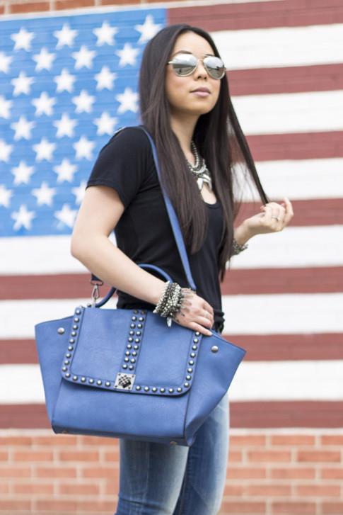 An Dyer wearing Ditto Brand Jeans, Melie Bianco Villette, Coco Rocha Senhoa Jewelry, Mirrored Aviators, Black Tee 3