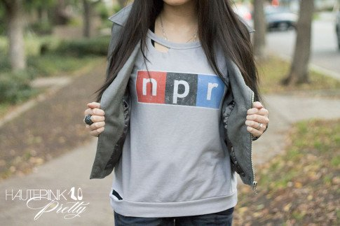An Dyer wearing NPR Sweatshirt Tee by Chaser Brand, Zara blue camo pants, Grey Perforated Leather Moto Jacket