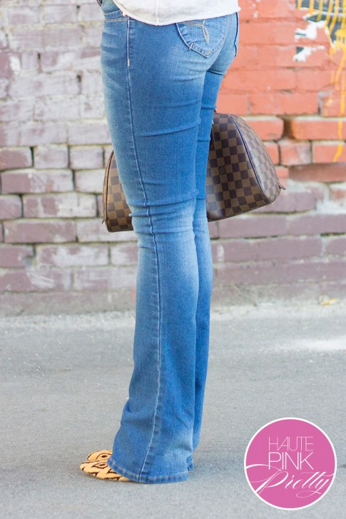 An Dyer wearing  YMI Want a Better Booty Boot Cut Jeans, Michael Stars Soy Cotton 3 4 Slv Wide Neck Pullover in Abalone,Sole Society Fergie Tribal Leopard