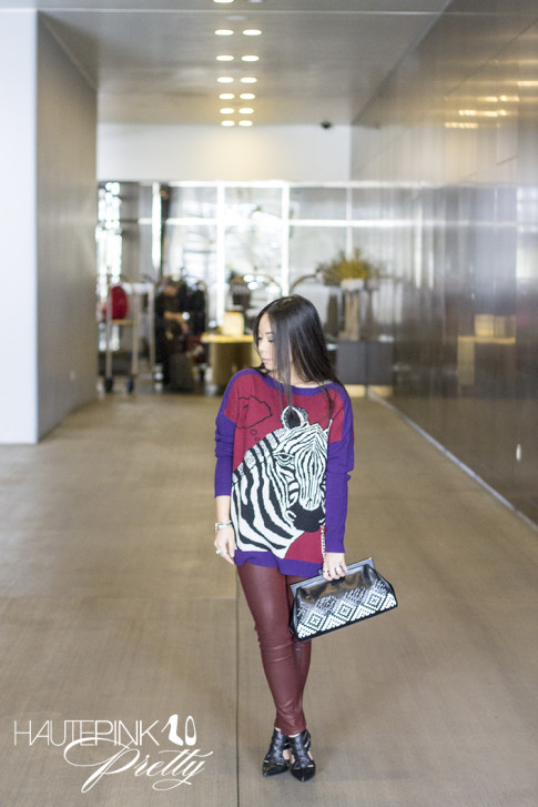 An Dyer wearing Ainsley Zebra TALA INTARSIA PULLOVER, Bleulab Ruby Coated Jeans, ShoeMint Garbo Pumps, Koret Woven Aztec Neo Framed Clutch Glint & Gleam Bracelet ShopLately