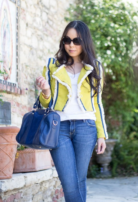 An Dyer wearing Lucy Paris Denim Fringe Chartreuse Jacket, Sole Society Kaylin Navy Bag, Fendi Classico Sunglasses, Levi's Skinny Jeans