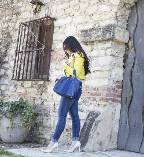 An Dyer wearing Lucy Paris Denim Fringe Chartreuse Jacket, Sole Society Kaylin Navy Bag & Rori Pumps, Fendi Classico Sunglasses, Levi's Jeans