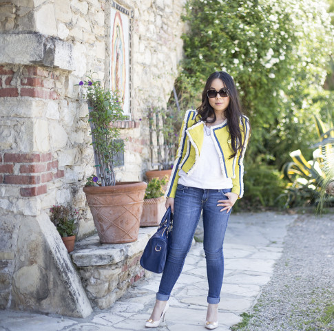 An Dyer wearing Lucy Paris Denim Fringe Chartreuse Jacket, Sole Society Kaylin Navy Bag & Rori Pumps, Fendi Classico Sunglasses, Levi's Skinnies