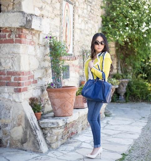 An Dyer wearing Lucy Paris Denim Fringe Chartreuse Jacket, Sole Society Kaylin Navy Bag & Rori Pumps, Fendi Classico Sunglasses, Levi's Skinny Jeans Cuffed