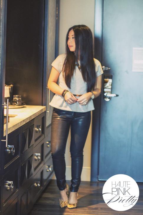 An Dyer wearing Maurie & Eve Heather Grey Peplum Top, Bleulab Coated Black reversible jeans, SoleSociety Fergie Tribal Leopard, Haute Betts Bracelets, Jewelmint Bracelet, Vivienne Kelly Necklace 2