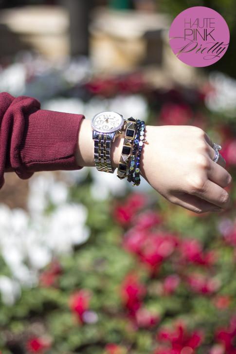 An Dyer wearing Michael Kors Mother of Pearl Chronograph Watch, ShopPublik black gold pyramid bracelet & Haute Betts Sanctuary Bracelets