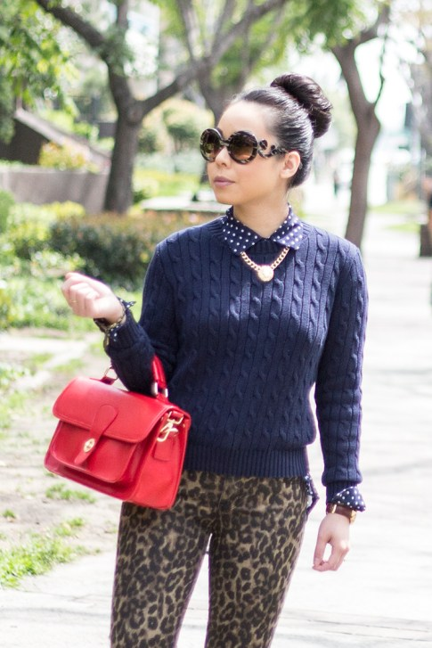 An Dyer wearing Sole Society Britt Messenger Bag in Red, Big Star Leopard Skinny Jeans, Navy Polka Dot Blouse, Prada Baroque Sunglasses, American Apparel Navy Cable Knit Pullover
