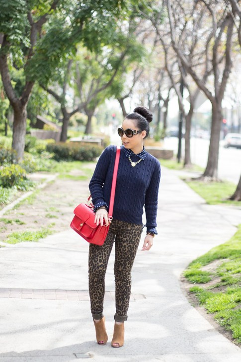 An Dyer wearing Sole Society Britt Messenger Bag in Red & Julianne Hough Angela Booties, Big Star Leopard Skinny Jeans, Navy Polka Dot Blouse, Prada Baroque Round Sunglasses, American Apparel Navy Cable Kn