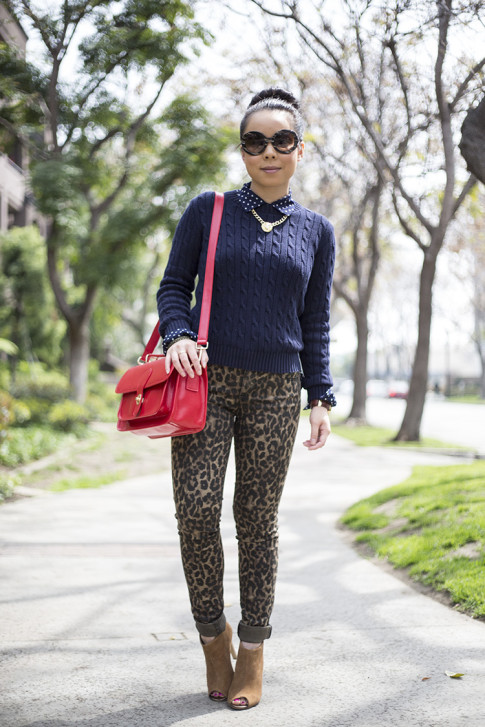 An Dyer wearing Sole Society Britt Messenger Bag in Red & Julianne Hough Angela Booties, Big Star Leopard Skinny Jeans, Navy Polka Dot Blouse, Prada Baroque Sunglasses, American Apparel Navy Cable Knit Pul