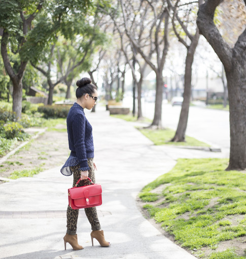 An Dyer wearing Sole Society Britt Messenger Bag in Red & Julianne Hough Angela Booties, Big Star Leopard Skinny Jeans, Navy Polka Dot Blouse, Prada Baroque Sunglasses, American Apparel Navy Cable Knit Swe