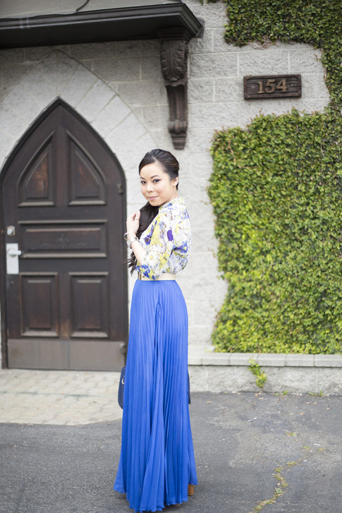 An Dyer wearing Bebe Pleated Maxi Skirt in Nautical Blue Cobalt, Sole Society Kaylin Navy Bag, Zara Blue Floral Blouse, Asos Studded Plate Belt