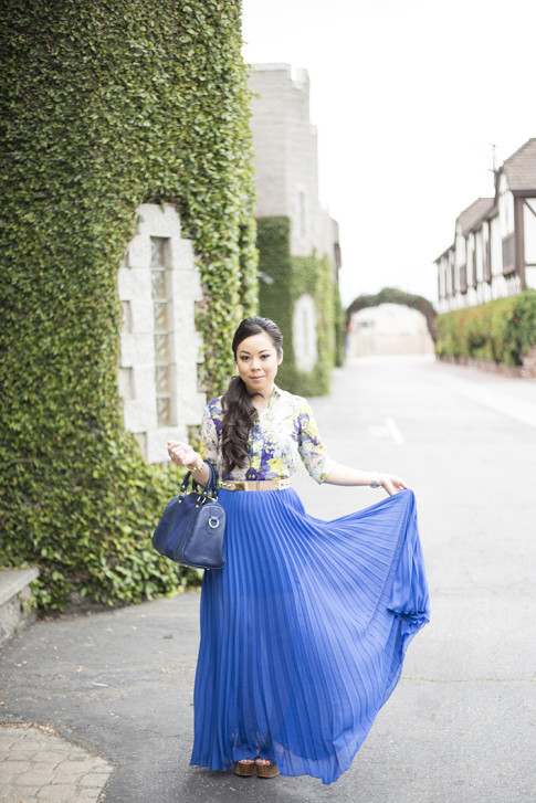 An Dyer wearing Bebe Pleated Maxi Skirt in Nautical Cobalt, Sole Society Kaylin Navy Bag, Zara Blue Floral Blouse, Asos Studded Plate Belt