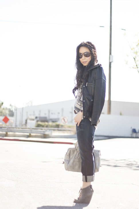 An Dyer wearing Fidelity Denim Girlfriend Jeans in River Blue, ShoeMint Jordane Mushroom, Frederick's of Hollywood Grey Satchel, Vaunt Snake Print Aviators, DKNY Leather Jacket