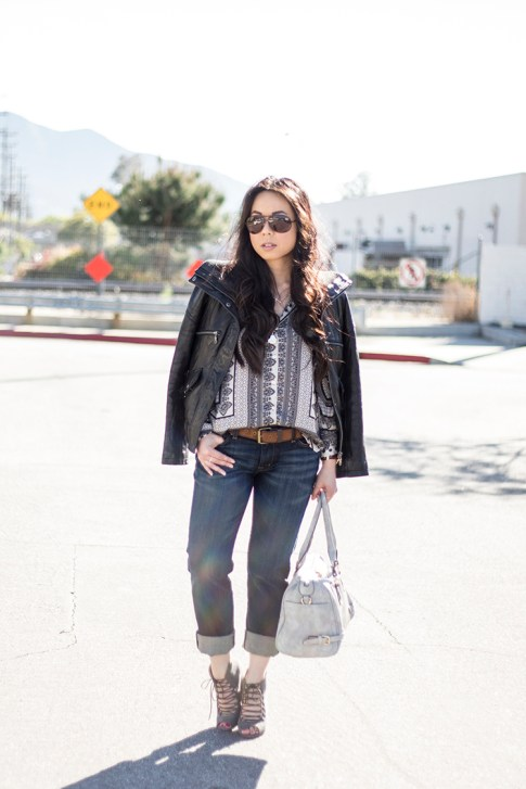 An Dyer wearing Fidelity Denim Girlfriend Jeans in River Blue, ShoeMint Jordane Mushroom, Frederick's of Hollywood Grey Satchel, Vaunt Snake Print Aviators, Violet Fly Delicate Thin Gold Rings, DKNY Jacket