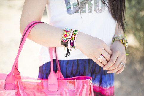An Dyer wearing Lovers & Friends California Grown Tank, BCBGMaxazria Carly Zipper Tote in Pink, Haute Betts Gypsy & Candy Pop Sweet Tarts Bracelets, Kim & Zozi Chain Bracelet, Nicki Jean Ring