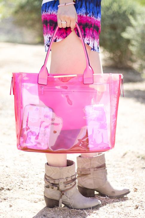 An Dyer wearing Lovers & Friends Tie Dye Woodstock Shorts, Steve Madden BackTalk boots, BCBGMaxazria Carly Zipper Tote in Pink