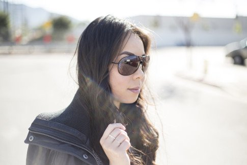 An Dyer wearing Vaunt Snake Print Aviators, Violet Fly Delicate Thin Gold Rings, DKNY Leathe