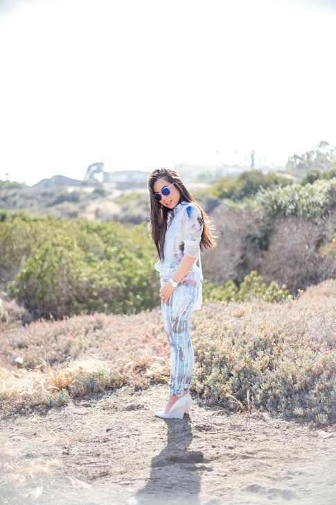 An Dyer wearing BleuLab Drip Tie Dye Ocean, Sole Society Elsie Bag in White, Glint & Gleam iridescent mirrored sunglasses, Zara White Wedge Pump & Denim Tropical Combined Shirt