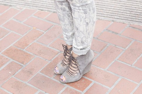 An Dyer wearing Bleulab Marble Tie Dye Jeans, ShoeMint Jordane Lace Up Wedges