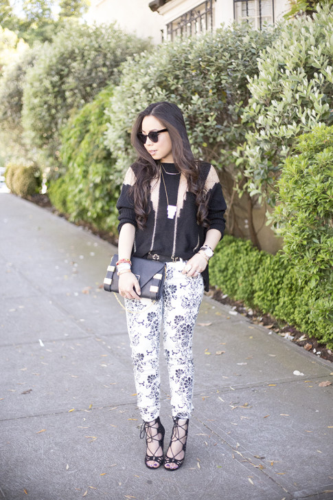 An Dyer wearing Fidelity Denim White Floral Jeans, ShoeMint Romy, ASOS Cross Belt, Rehab Black Sheer Mesh Sweater