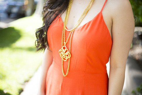 An Dyer wearing Line & Dot Orange Jumpsuit, Ben-Amun Layered Pendant Necklace