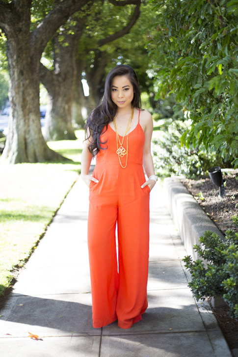 An Dyer wearing Line & Dot Orange Jumpsuit, Ben-Amun Layered Pendant Necklace, Hermes Hapi 3mm Bracelet