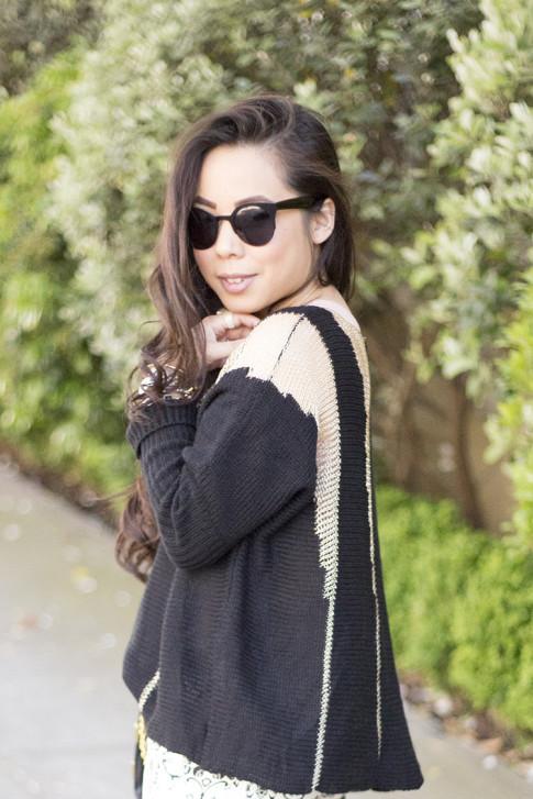 An Dyer wearing Rehab Black Sheer Mesh Sweater, Black Cat Eye Metal Sunglasses
