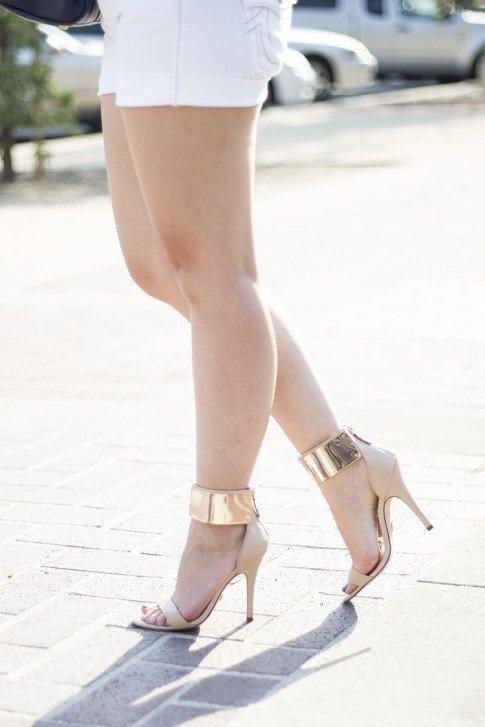 An Dyer wearing True Religion Jayde Boyfriend Cut Off Shorts, Bebe Jacqueline Gold Cuff Sandals
