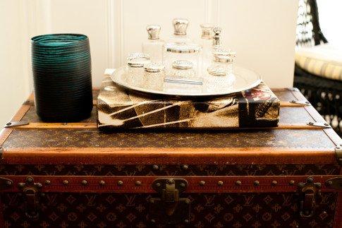 Bailey 44 Brunch Interior Decor Louis Vuitton Trunk and Vintage Silver Crystal Perfume Bottles