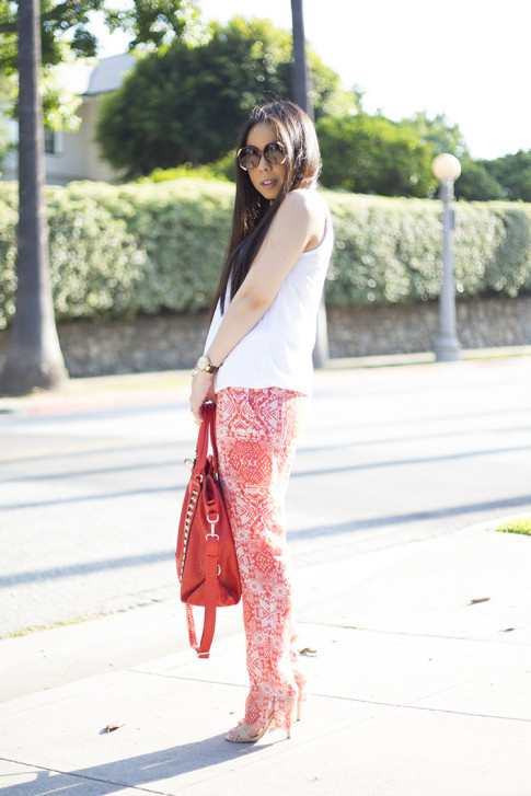 An Dyer wearing Michael Stars Sleeveless Scoop Neck Tank Dress, Chaser Brand Red Tribal Pants, V-Couture by Kooba Ruby Contour Studded Convertible Tote in Coral, Bebe Jacqueline Sandal