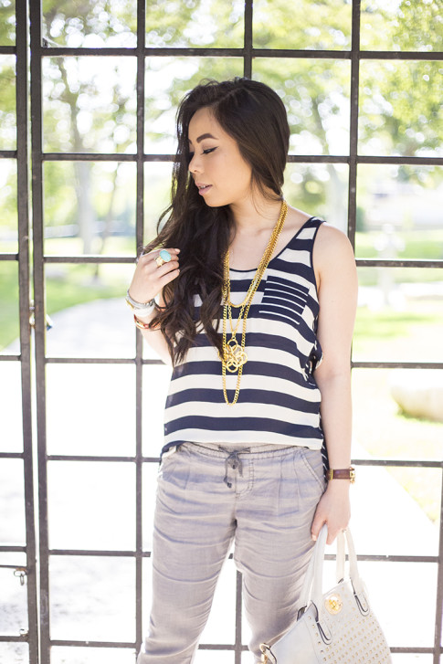 An Dyer wearing Michael Stars Stripe Silk Georgette Scoop Neck Tank Cuffed Ankle Pant w Tuxedo Stripe, Ben-Amun Layered Pendant Necklace, Frederick's of Hollywood Cream Studded Tote Bag, Sole Society Bracelets, Hermes Hapi