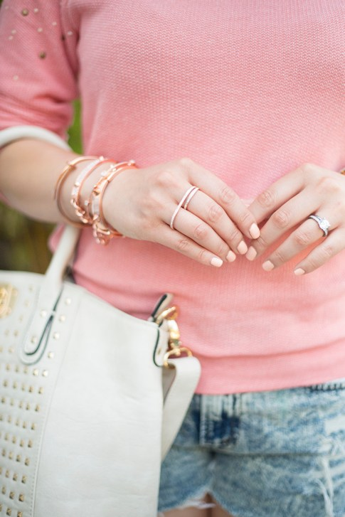An Dyer wearing Natalie B Rose Gold Double Finger Ring, Glint & Gleam Rose Gold Bracelet Nail Bangles ShopLately