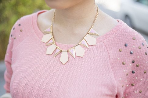 An Dyer wearing Rewind Stud Sweatshirt in Peach from Kohls, ShopLately Glint & Gleam Tribal Petals Necklace - Peach and Pink