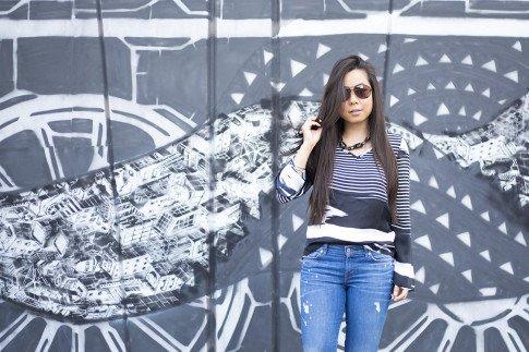 An Dyer wearing Vaunt Black Snake Print Etched Aviator Sunglasses, Rich & Skinny Clinton Peg Jeans, JewelMint Shadow Link Necklace, Vintage Havana Striped BW Top