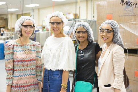 Vogue Influencers Visit OPI Headquarters - Touring the facilities with hair nets - Beth Jones BJonesStyle, Marra Ferreira MLovesM, Sheryl Luke WalkInWonderland, An Dyer HautePinkPretty
