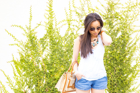 An Dyer wearing Brahmin Atelier Brookline Satchel, Zara Chambray Denim Shorts, Foster Grant Aviator Sunglasses, Honeydew Intimates Diamondback Tank