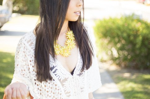 An Dyer wearing Sole Society Citrine OVERSIZED FLORAL NECKLACE, LIV los angeles crochette caftan